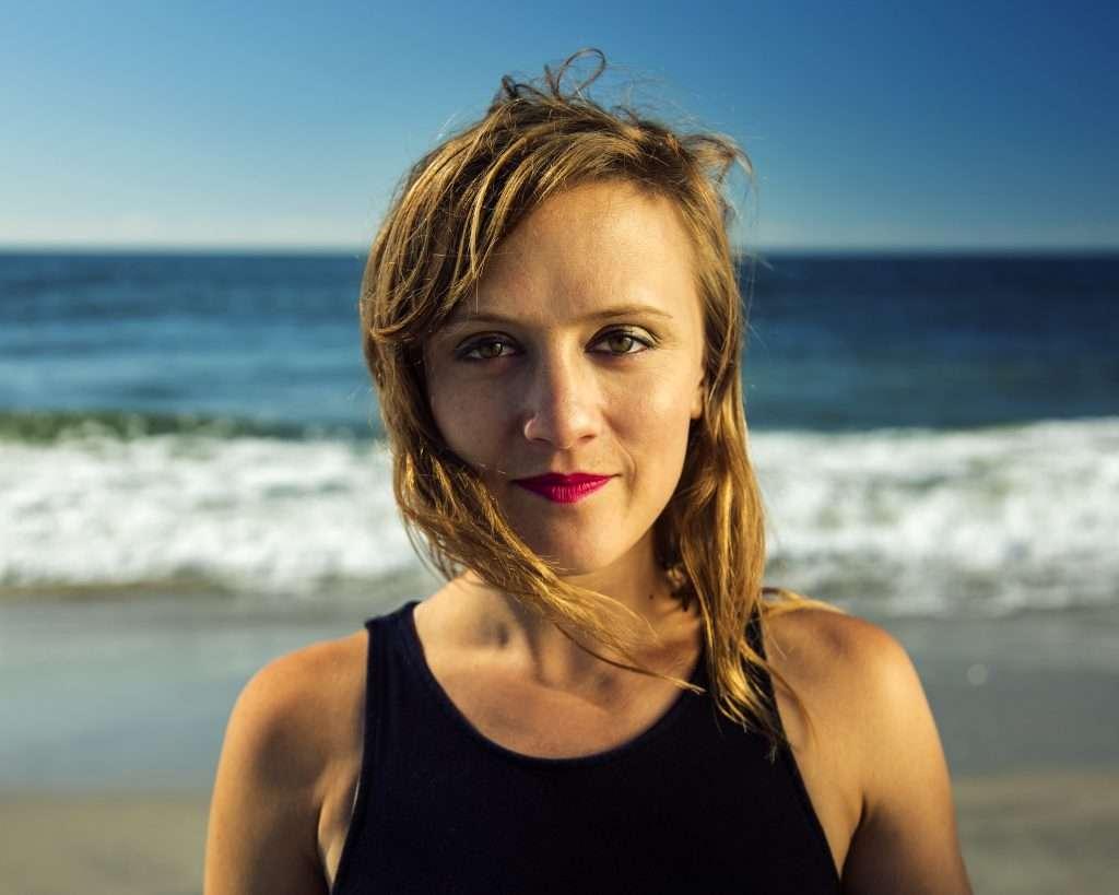 portrait of Ellen Reid in front of the ocean